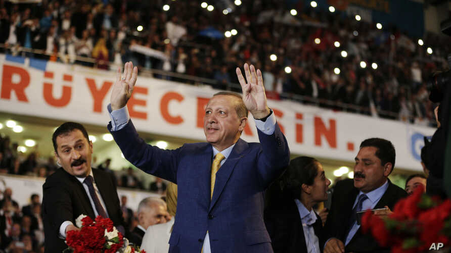 Turkey's President Recep Tayyip Erdogan waves to supporters as he arrives for a congress of the ruling Justice and Development Party (AKP) in Ankara, Turkey, May 21, 2017.