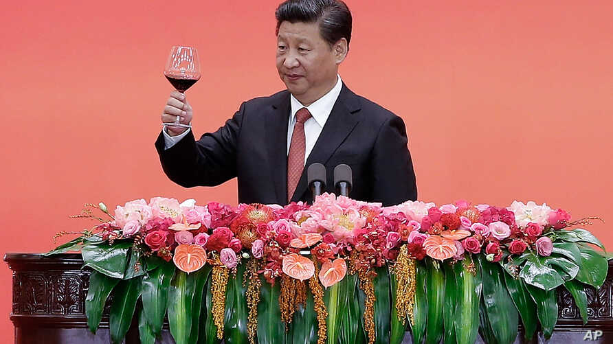 FILE - Chinese President Xi Jinping offers a toast after delivering a speech during a reception to mark the 70th anniversary of Japan's surrender during World War II in Beijing.