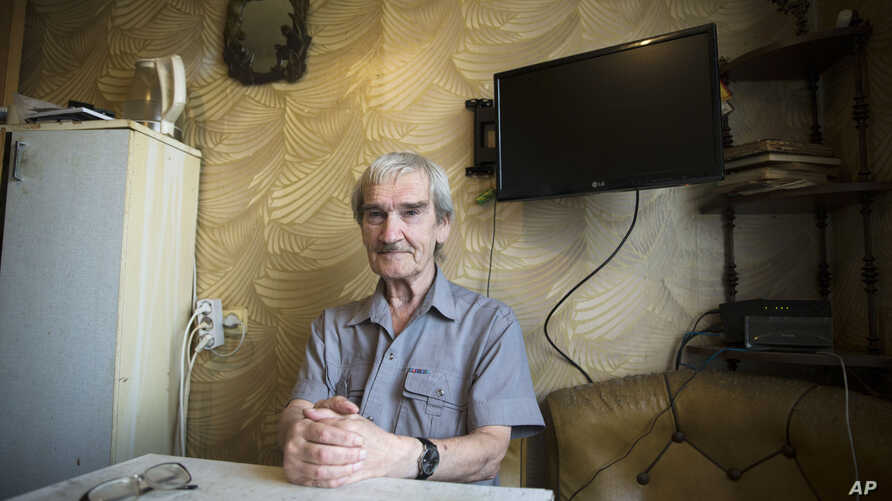 In this Thursday, Aug. 27, 2015 photo former Soviet missile defense forces officer Stanislav Petrov poses for a photo at his home in Fryazino, Moscow region, Russia.