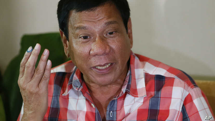 Front-running presidential candidate  Mayor Rodrigo Duterte gestures during his second news conference after voting in a polling precinct at Daniel R. Aguinaldo National High School, Matina district, his hometown in Davao city in southern Philippines