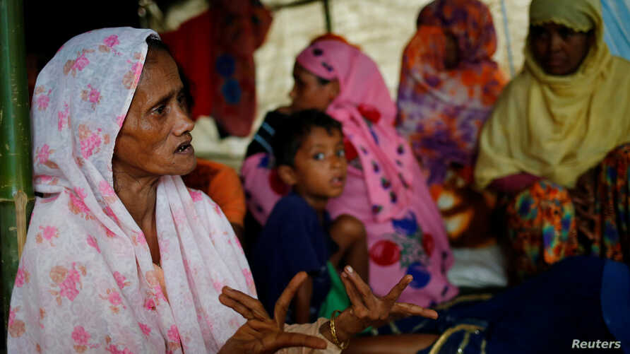 Shamsun Nahar (left), 60, a Rohingya widow who fled from Kha Maung Seik village of Myanmar to Bangladesh alone, whose 30-year-old son is missing, tells her story at Kutupalang Makeshift Camp in Cox's Bazar, Bangladesh, Sept. 4, 2017.