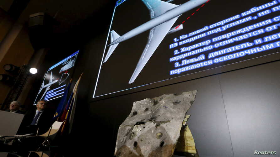 A sample and graphic materials are displayed during a news conference, organized by officials of Russian missile manufacturer Almaz-Antey and dedicated to the results of its investigation into Malaysia Airlines flight MH17 crash in eastern Ukraine, i