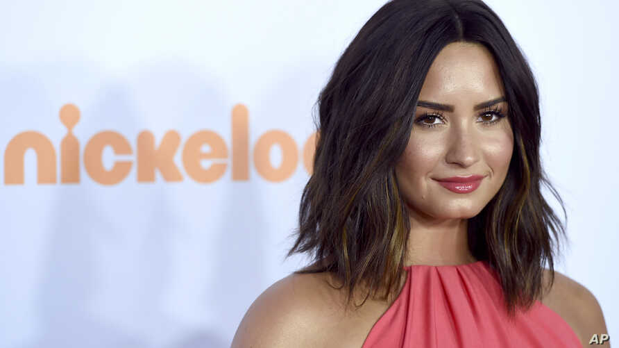 FILE - Demi Lovato arrives at the Kids' Choice Awards at the Galen Center in Los Angeles.