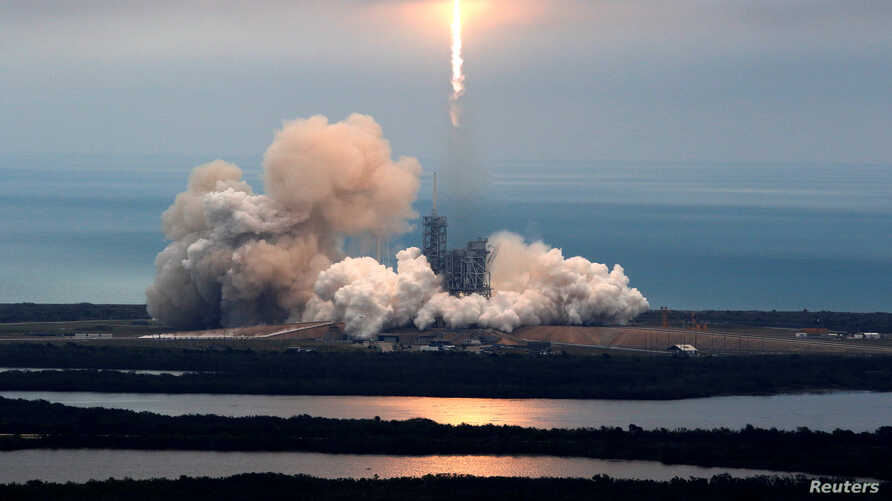 A SpaceX Falcon 9 rocket disappears into clouds after it lifted off on a supply mission to the International Space Station from historic launch pad 39A at the Kennedy Space Center in Cape Canaveral, Florida, U.S., February 19, 2017.