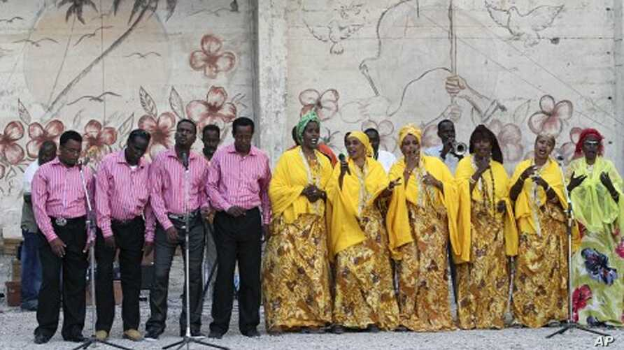 Somali national singers perform at the National Theater in Somalia's capital Mogadishu, March 19, 2012.