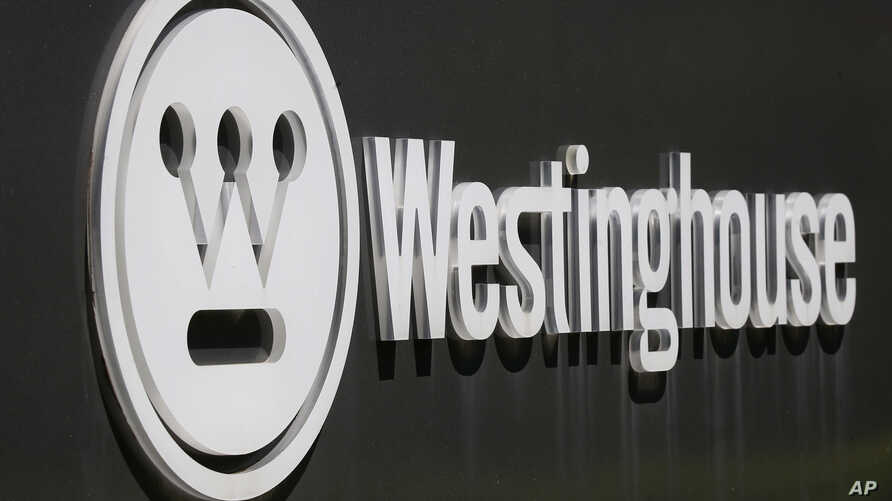 FILE - The corporate logo is on the sign marking the driveway to the Westinghouse International Headquarters in Cranberry, Pa., May 19, 2014.