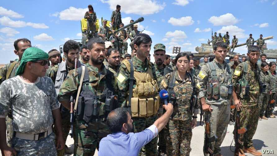 Soldiers participating in operation to liberate Raqqa, Syria from Islamic State militants, May 24, 2016. (Photo: courtesy ANHA)