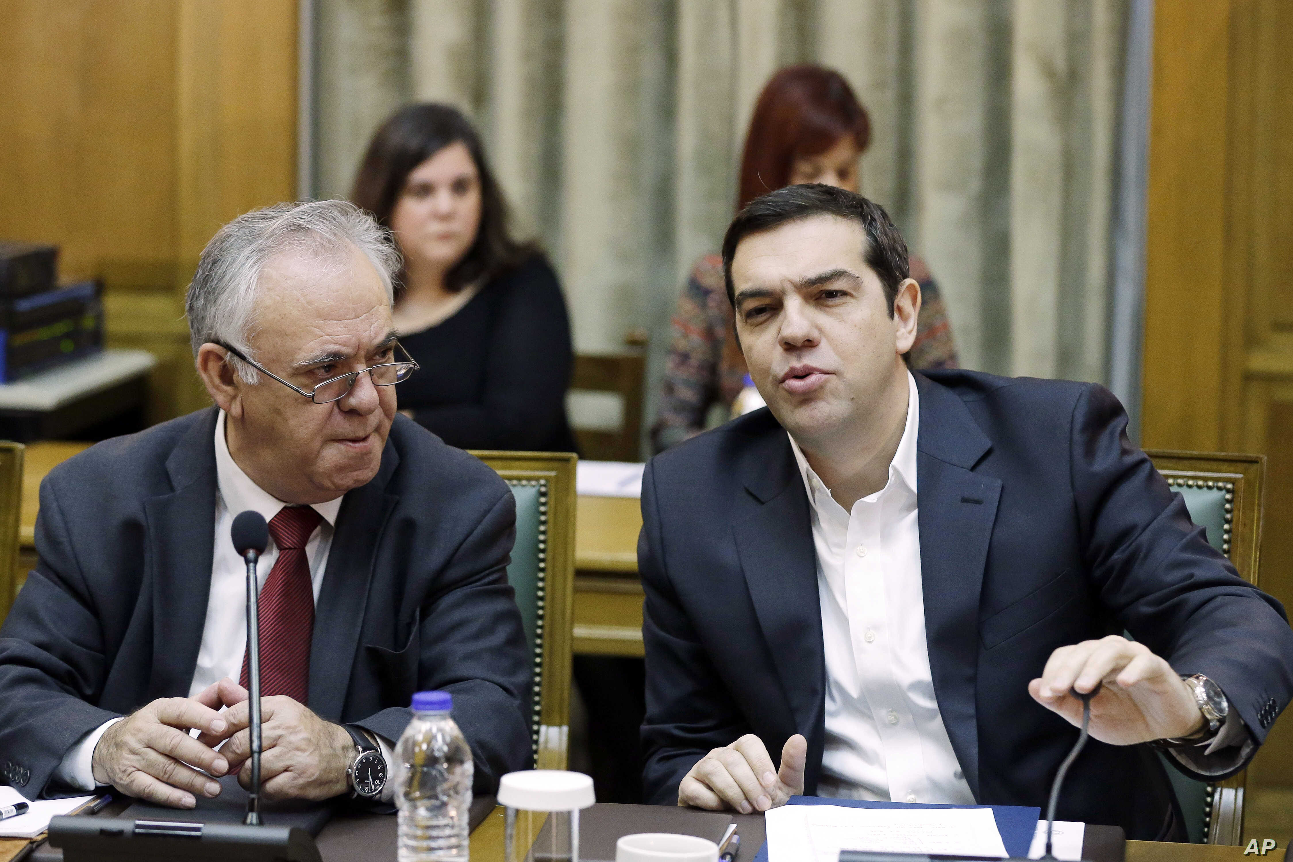 Greece's Prime Minister Alexis Tsipras, right, speaks during a cabinet meeting as Deputy Prime Minister Yannis Dragasakis listens to him in Athens, Nov. 10, 2015.