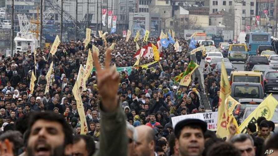 Demonstrators march with yellow Peace and Democracy Party (BDP) flags and display outlawed Kurdistan Workers Party (PKK) banners during a protest against the High Election Board's decision in Istanbul, April 19, 2011