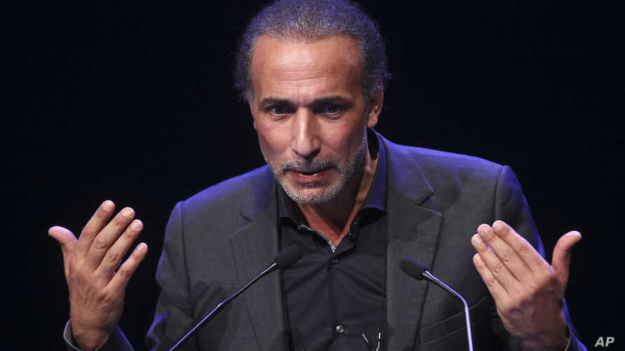 FILE - Prominent Islamic scholar Tariq Ramadan delivers a speech at a French Muslim organization's meeting in Lille, northern France, Feb. 7, 2016.