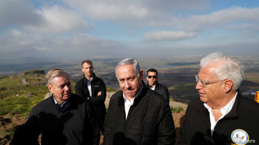 Israeli Prime Minister Benjamin Netanyahu, U.S. Republican Senator Lindsey Graham and U.S. Ambassador to Israel David Friedman visit the border line between Israel and Syria at the Israeli-occupied Golan Heights, March 11, 2019.