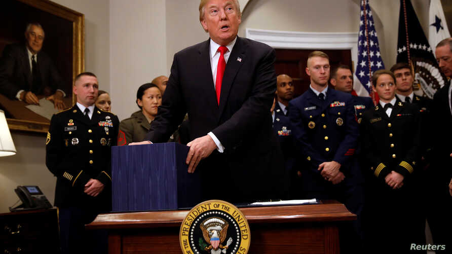 President Donald Trump participates in a signing ceremony for the National Defense Authorization Act for Fiscal Year 2018 at the White House, Dec. 12, 2017.