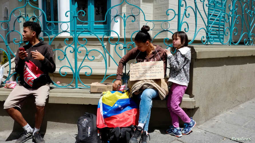 Venezuelan migrants are seen in the center of La Paz, Bolivia March 29, 2019. Picture taken March 29, 2019.