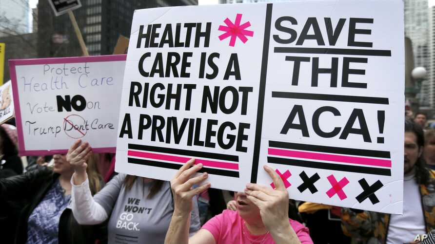 FILE - Protesters gather across the Chicago River from Trump Tower to rally against the repeal of the Affordable Care Act, March 24, 2017, in Chicago.