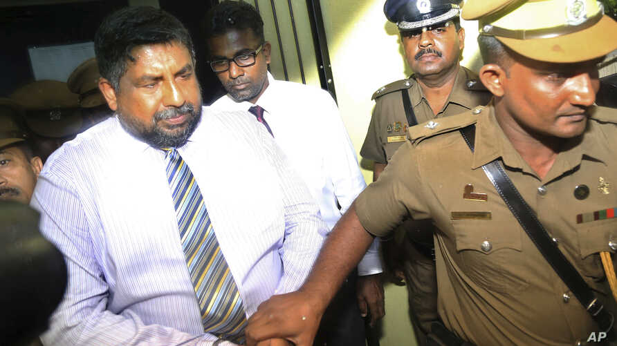 Chief of Defense Staff Admiral Ravindra Wijegunaratne is taken away by police officers from a court in Colombo, Sri Lanka, Nov. 28, 2018.