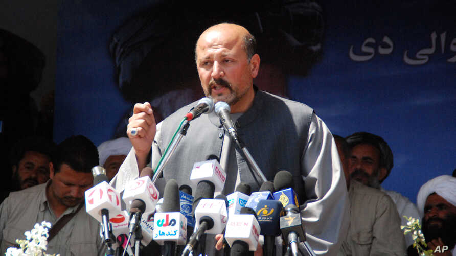 Hashmat Khalil Karzai, a cousin of Afghan President Hamid Karzai speaks during an election campaign rally in Kandahar province south of Kabul, Mar. 24, 2014.
