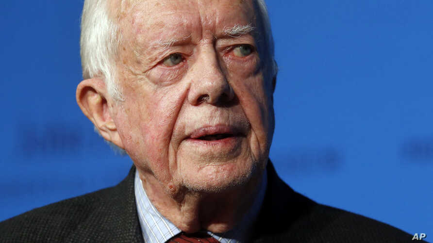 FILE - Former U.S. President Jimmy Carter speaks during a forum in Boston, Aug. 12, 2015. Carter  is undergoing treatment for cancer.