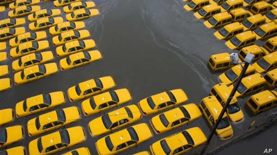 Parking lot full of yellow cabs flooded as a result of superstorm Sandy, Hoboken, NJ, Oct. 30, 2012.