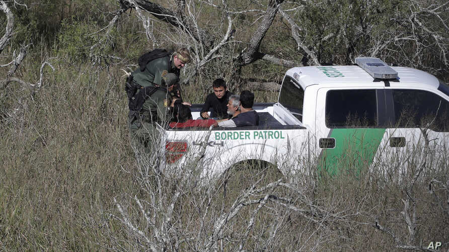 U.S. Customs and Border Patrol agents stop a group of suspected illegal immigrants passing through a ranch near Edinburg, Texas, NOV. 15, 2016.