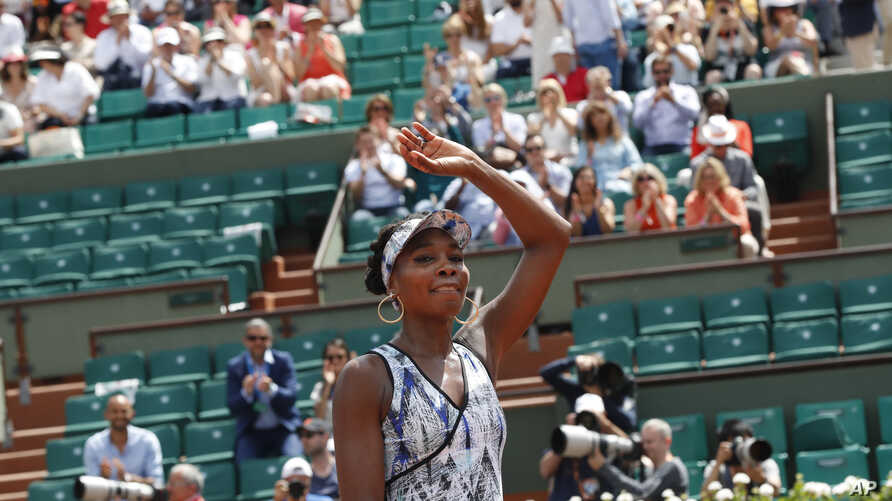 Venus Williams celebrates winning 6-3, 6-1, against Japan's Kurumi Nara during their second round match of the French Open tennis tournament at the Roland Garros stadium, in Paris, May 31, 2017.