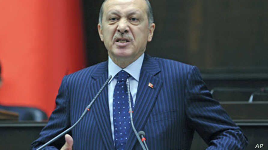 Turkey's Prime Minister Tayyip Erdogan addresses members of parliament from his ruling AK Party during a meeting at the Turkish parliament in Ankara, Turkey, November 22, 2011.
