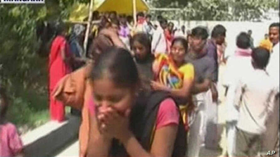 Video grab from Headlines Today television channel shows an Indian woman crying at the scene of a stampede in Pratapgarh, southeast of New Delhi, 04 Mar 2010