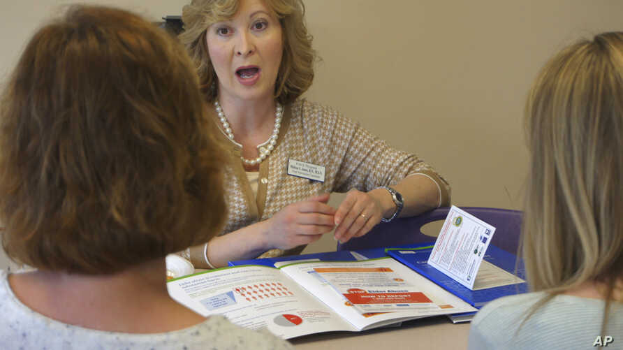 Melissa Jones, center, a nurse educator with Alosa Health, speaks with social worker Jean Easter, left, and physician's assistant Emily Braunegg at a medical office in Monroeville, Pa., May 4, 2017. Jones visits medical offices in western Pennsylvani
