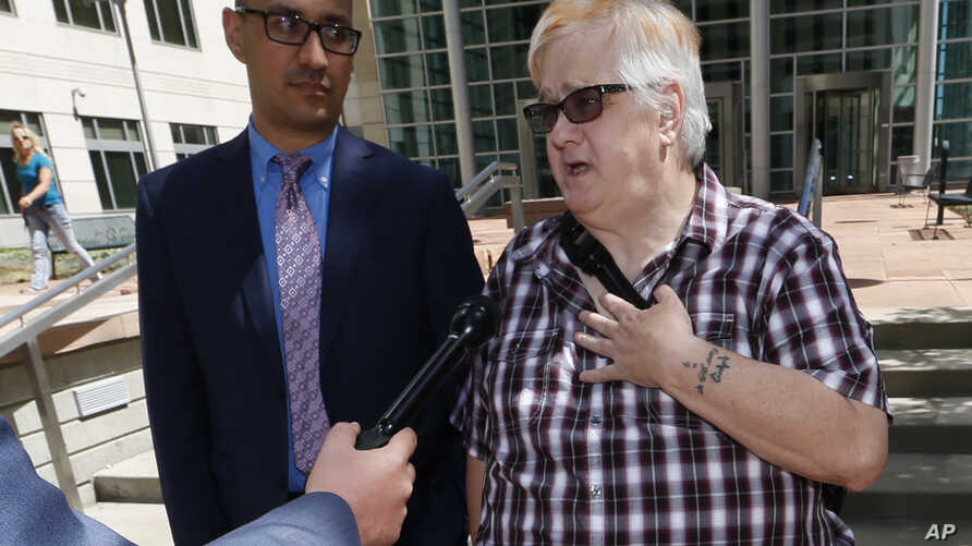 Dana Zzyym of Fort Collins, Colo., right, talks about the arguments in a hearing on Zzyym's lawsuit requiring people to pick a gender to get a passport outside the U.S. Federal Courthouse in Denver, July 20, 2016.