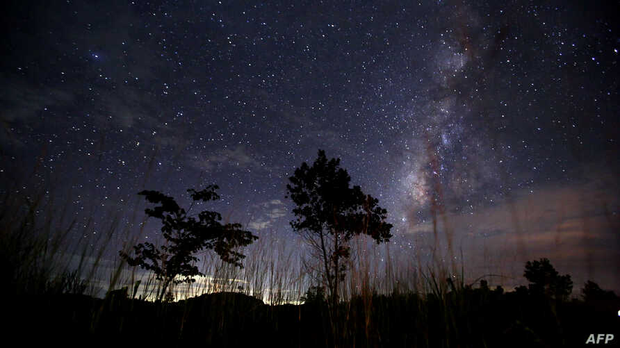This long-exposure photograph taken on August 12, 2013 shows the Milky Way in the clear night sky near Yangon. The Perseid meteor shower occurs every year in August when the Earth passes through the debris and dust of the Swift-Tuttle comet.