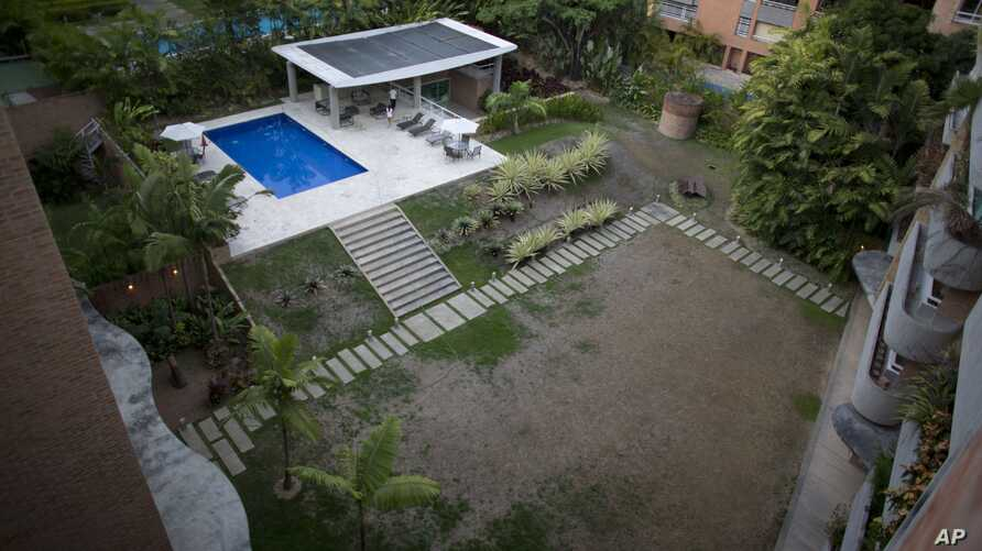 Grass sits dry due to the lack of water, at a wealthy apartment complex in Caracas, Venezuela, June 11, 2018.