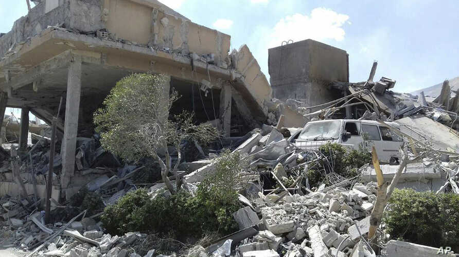 This photo released by the Syrian official news agency SANA shows the damage of the Syrian Scientific Research Center, which was attacked by U.S., British and French military strikes to punish President Bashar al-Assad for suspected chemical attack a