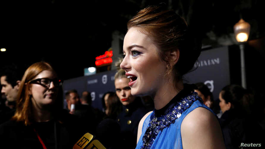 """Cast member Emma Stone is interviewed at the premiere of """"La La Land"""" in Los Angeles, Dec. 6, 2016. The musical was named one of 2016's top 10 movies by the American Film Institute, Thursday, Dec. 8, 2016."""