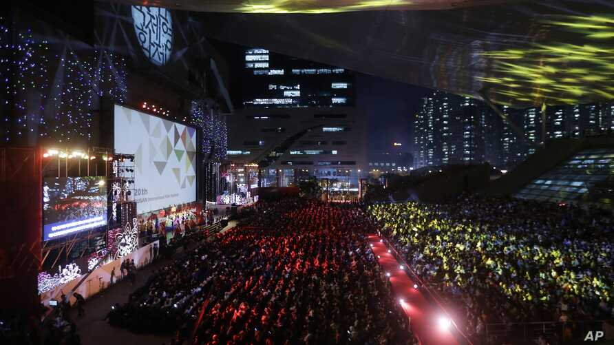 People attend the opening ceremony of the Busan International Film Festival at Busan Cinema Center in Busan, South Korea, Oct. 1, 2015.