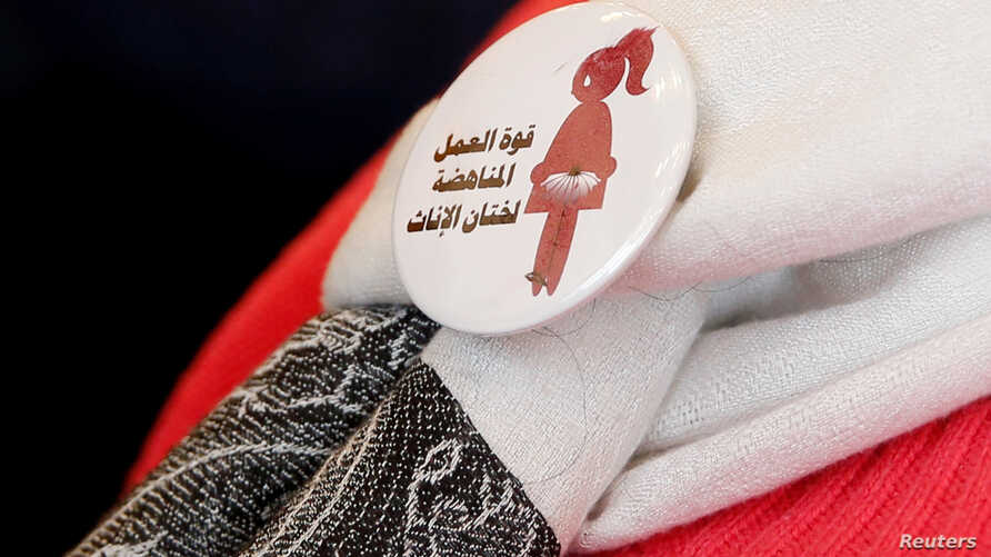 """A badge reads """"The power of labor aginst FGM"""" is seen on a volunteer during a conference on International Day of Zero Tolerance for Female Genital Mutilation in Cairo, Egypt, Feb. 6, 2018."""
