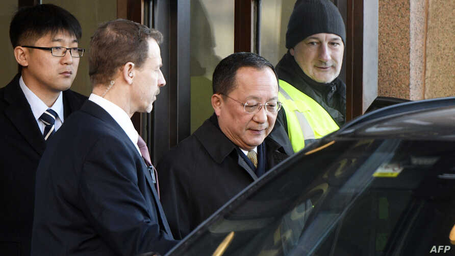 North Korean Foreign Minister Ri Yong Ho (C) leaves the Swedish goverment building Rosenbad in central Stockholm, March 16, 2018.