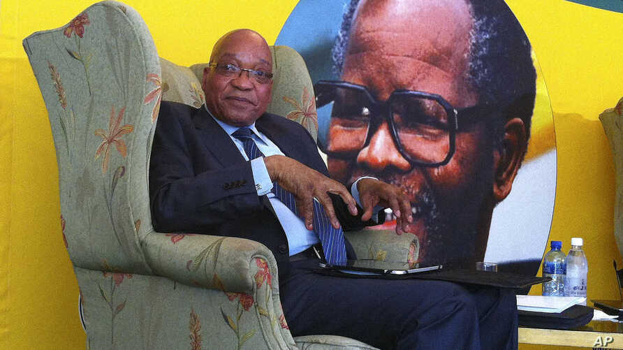 South African president Jacob Zuma, in front of a portrait of former African National Congress president Oliver Tambo, addresses foreign correspondents at a breakfast in Johannesburg, Monday, Oct. 29, 2012.