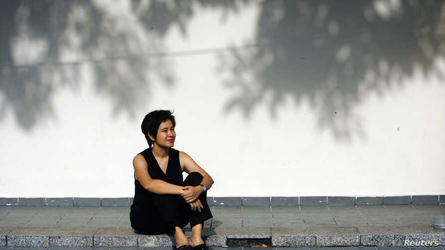 """Filmmaker Tan Pin Pin poses during a 2007 photo shoot in Singapore.  Her film, """"To Singapore, with Love"""" was banned by the government in Singapore."""