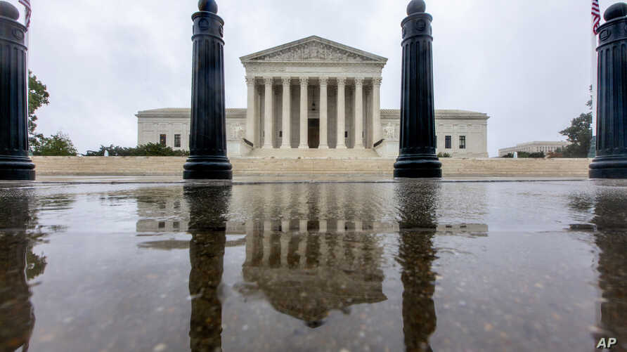 The Supreme Court is seen in Washington, Sunday, Sept. 23, 2018. With the opening of the high court's new term approaching, President Trump is anxious for his Supreme Court nominee Brett Kavanaugh to be confirmed by the Senate.