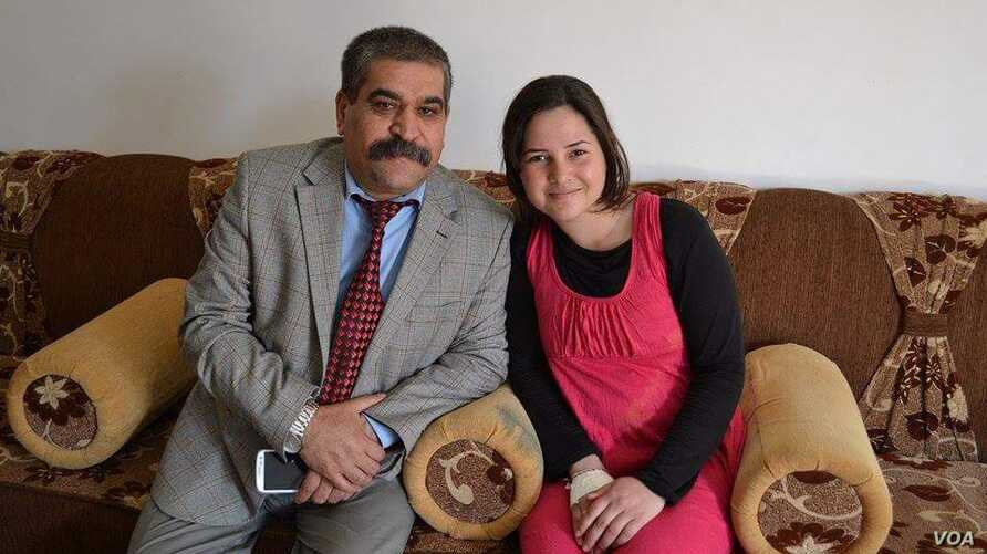 Sarah Said Haydar, 16, with her father before her capture by Islamic State militants last August.