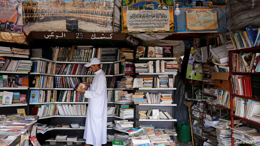 A man reads a book at a bookshop in Bab Doukkala in the city of Marrakech, Morocco, May 13, 2017.