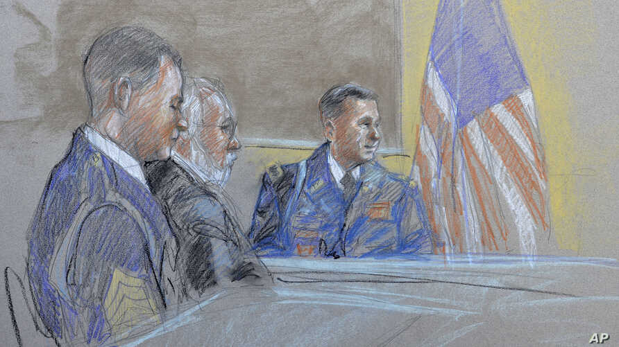 Capt. John Billings (R) is questioned as Sgt. Bowe Bergdahl (L) and lead defense counsel Eugene Fidell look on during a preliminary hearing to determine if Sgt. Bergdahl should face a court-martial, Sept. 17, 2015, at Fort Sam Houston in San Antonio,...