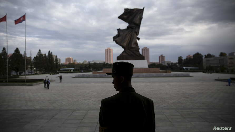 A soldier stands guard at the doors of the War Museum visited by foreign reporters during a government-organized tour in Pyongyang, North Korea, Oct. 9, 2015.