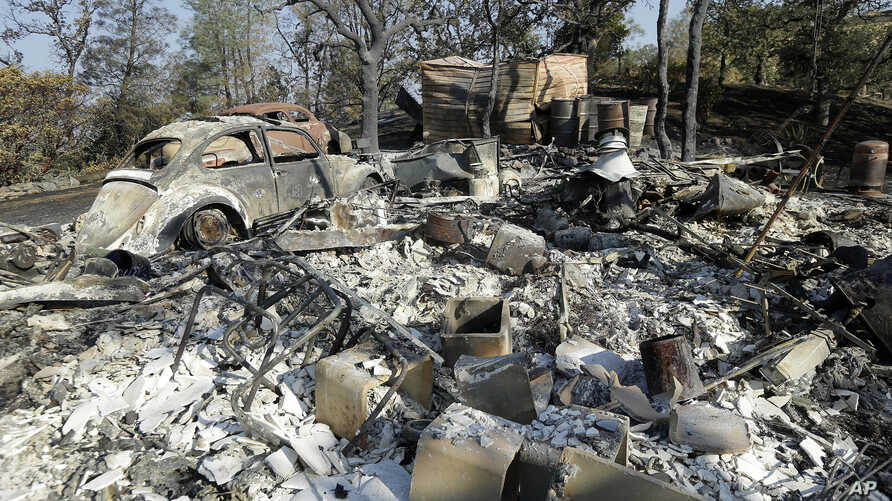 The charred remains of a property is shown near Clearlake, Calif., Aug. 6, 2015.