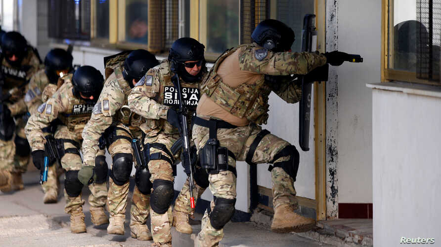 Participants of the European Union Force (EUFOR), Armed Forces, Border Police and State Investigation and Protection Agency (SIPA) of Bosnia and Herzegovina practice an anti-terrorism situation during an exercise at the Sarajevo International Airport