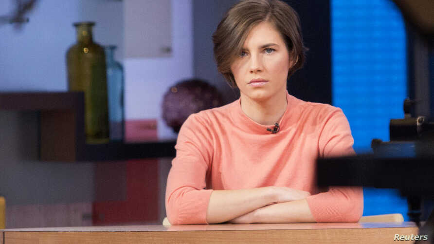 """Amanda Knox sits alone before being interviewed on the set of ABC's """"Good Morning America"""" in New York, Jan. 31, 2014."""