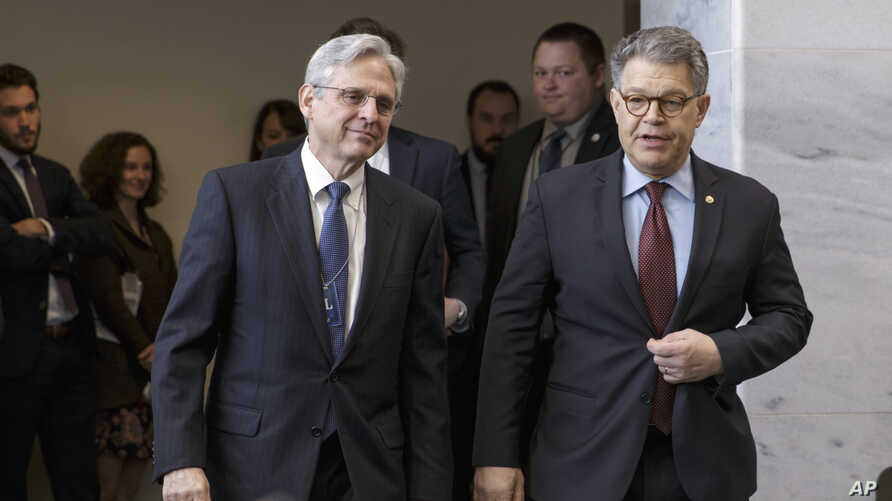 Judge Merrick Garland (L), President Barack Obama's choice to replace the late Justice Antonin Scalia on the Supreme Court, meets with Senate Judiciary Committee member, Democratic Senator Al Franken, on Capitol Hill in Washington, March 30, 2016.