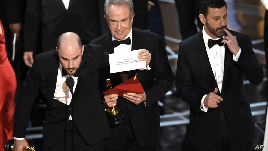 "Jordan Horowitz shows the envelope revealing ""Moonlight"" as the true winner of best picture at the Oscars, Feb. 26, 2017, at the Dolby Theatre in Los Angeles."