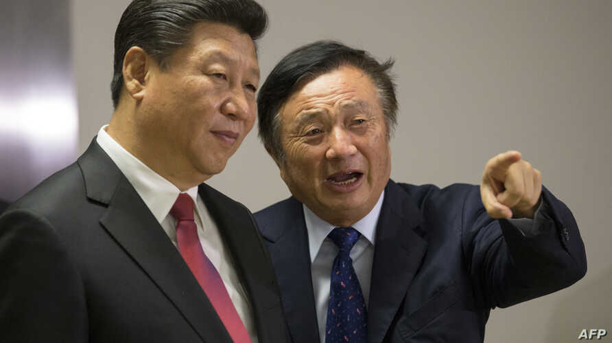 FILE - Chinese President Xi Jinping, left, is shown around the offices of Chinese tech firm Huawei technologies by its President Ren Zhengfei in London during his state visit, Oct. 21, 2015.