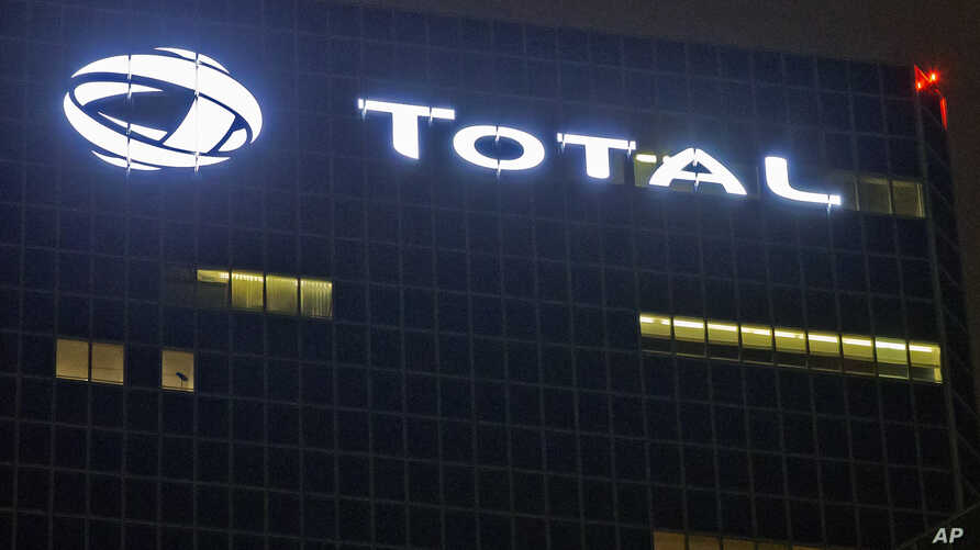 FILE - In this file photo taken on Oct.12, 2016, the logo of French oil giant Total SA is pictured at company headquarters in La Defense business district, outside Paris.