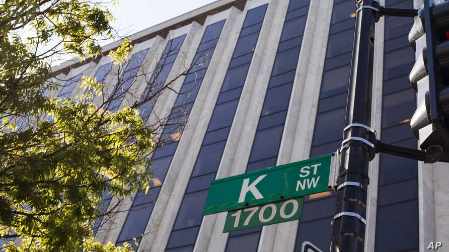 "FILE - Known as a center for lobbyists, lawyers, and think tanks, the K Street corridor is seen in northwest Washington at 18th Street, May 3, 2018. In political discourse, ""K Street"" has become synonymous with the effort by high-power advocacy group"